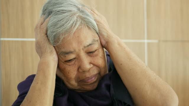 Asian senior woman patient headache video