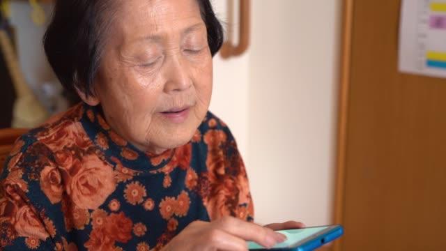 Asian senior woman using smart phone