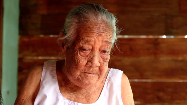 Asian senior woman wiping tears video