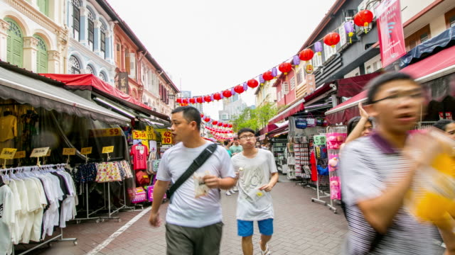 Asian Singapore people walking in China Town shopping  area video