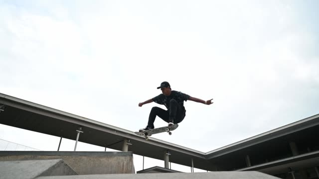 Asian skateboarder in action Asian skateboarder in action urban fashion stock videos & royalty-free footage