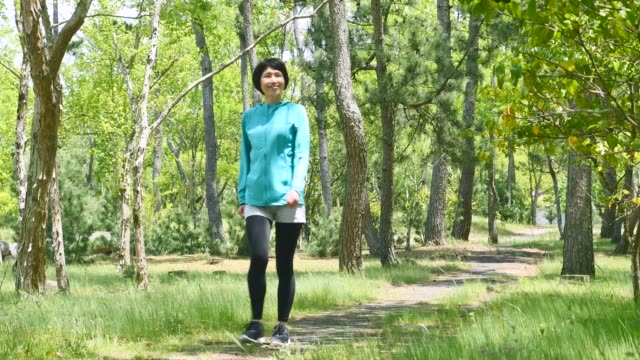 asian sportswoman in the forest - stay at home parent stock videos & royalty-free footage