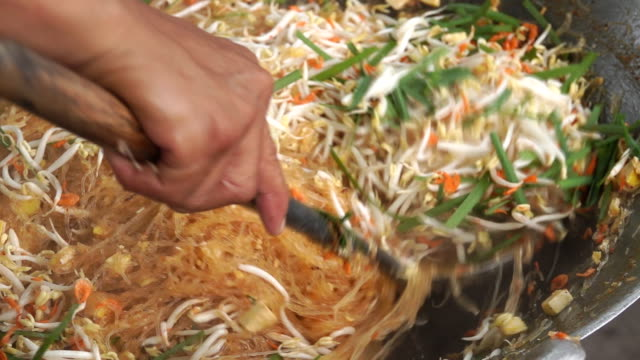 Asian Street food: Chef Cooking Pad Thai, Street food : thai man is cooking pad thai noodle with egg at night food market in Thailand