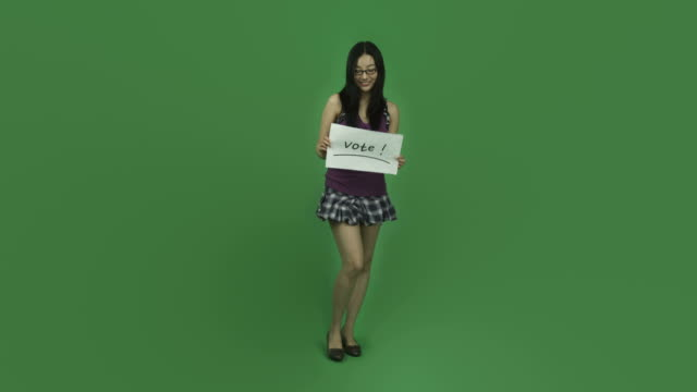 Asian student girl isolated greenscreen green background with vote sign video