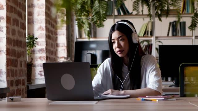 asian student girl talking via video chat, denying suggestion to meet offline - negacja filmów i materiałów b-roll
