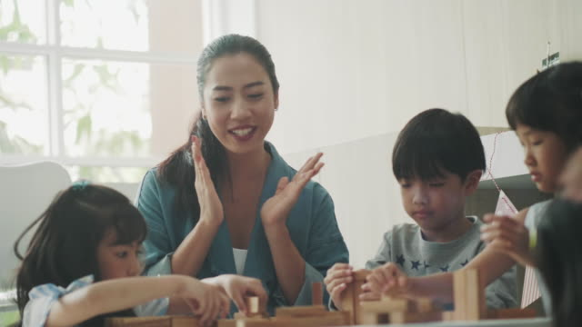 Asian Teacher teaching students Southeast Asian teacher is cheering her students while playing wooden toy for mathematics class thai ethnicity stock videos & royalty-free footage