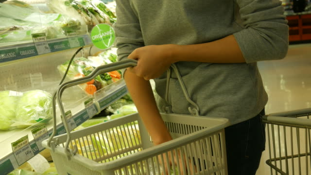 Asian teenage woman shopping in supermarket Asian teenage woman shopping in supermarket , Close-up nutritionist stock videos & royalty-free footage