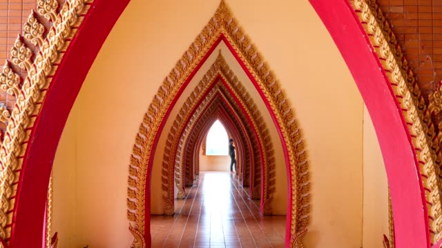 Asian temple arch door with tourists walking at Wat Tham Sua