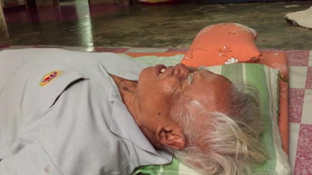 asian thai old man hurt while thai massage - china drug video stock e b–roll