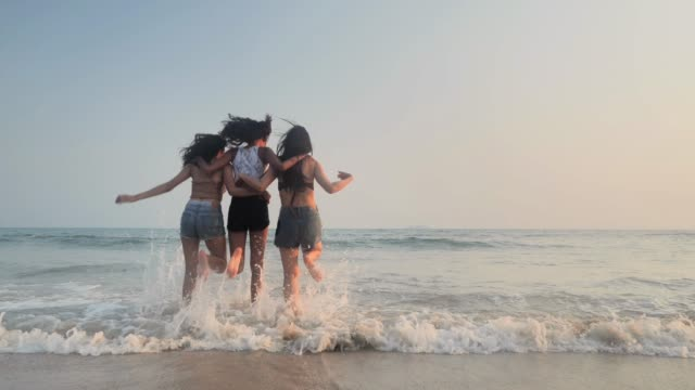 Asian three young female friends having fun at sunset beach.Beach holidays travel concept.Travel Cinemagraphs Travel Cinemagraphs :Asian three young female friends having fun at sunset beach.Beach holidays travel concept. beach party stock videos & royalty-free footage