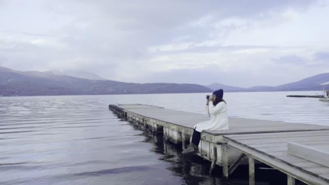 Asian tourist woman taking picture at scenic view of Lake Kawaguchi