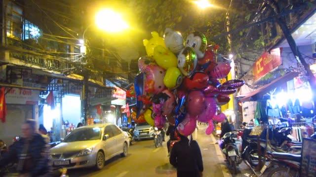 Asian Vendor Selling Balloons video