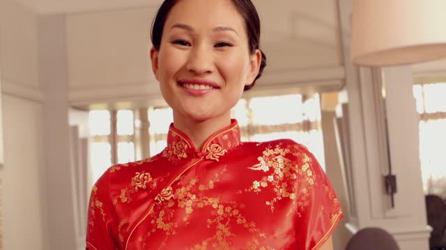 Asian waitress smiling at camera video