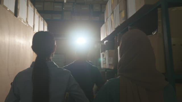 Asian warehouse team work walking to company for prepare product ship to customer.