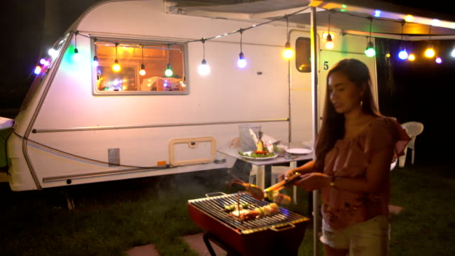 asian woman at a barbecue grill - caravan stock videos & royalty-free footage