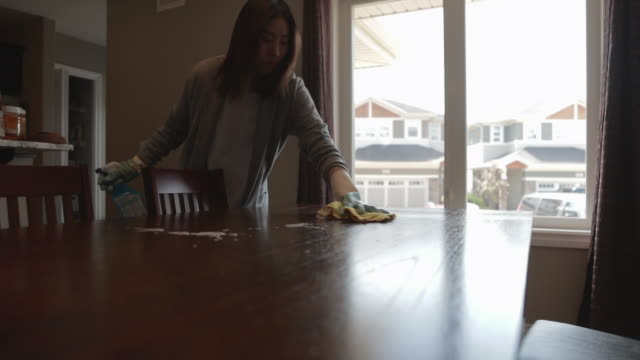 Video asian woman cleaning home
