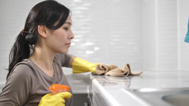 Asian Woman Cleaning Untidy Kitchen Asian Woman Cleaning Untidy Kitchen washing dishes stock videos & royalty-free footage