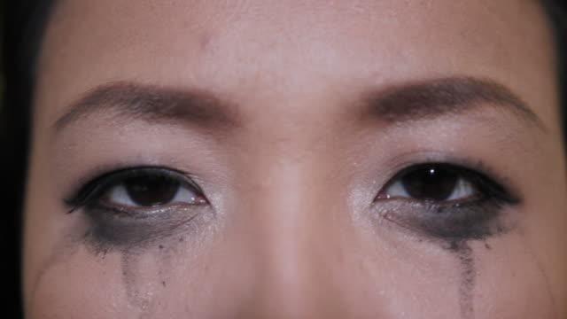 Asian woman crying mascara video
