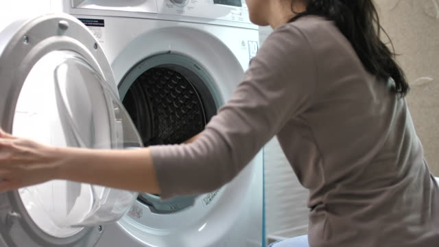 Asian Woman doing the laundry Asian Woman doing the laundry laundry basket stock videos & royalty-free footage