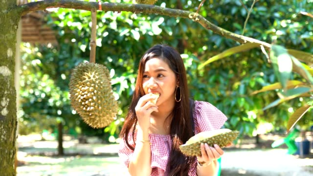 Asian woman eating durian