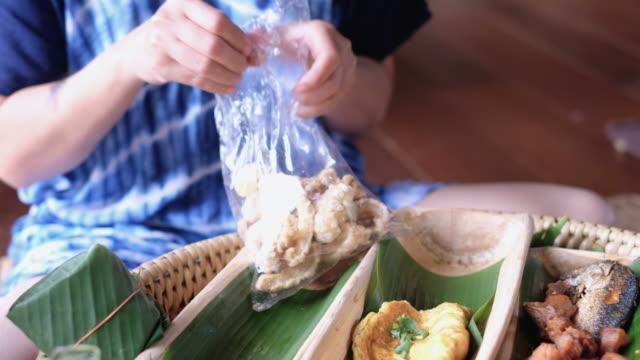 "Asian woman eating tradition northern thai food ""khan toke"""