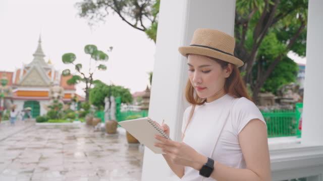 Asian woman Enjoying for landmark of Bangkok Wat Phra Kaeo in Bangkok City