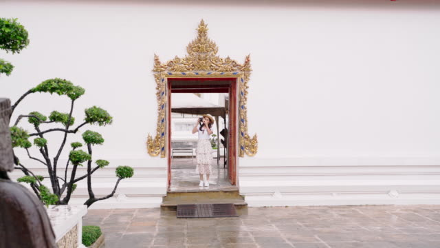 Asian woman Enjoying for Traveling at Wat Pho in Thailand