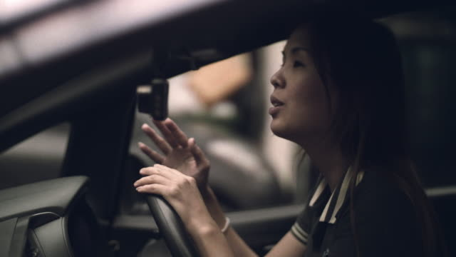 Asian Woman Enjoying Music In Car video