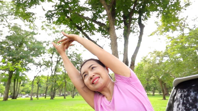 Asian Woman exercising on a park, Slow motion