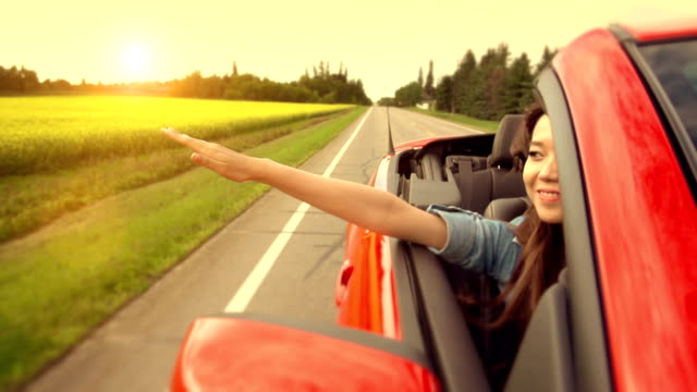 asian woman experiences freedom on the highway - active lifestyle stock videos and b-roll footage
