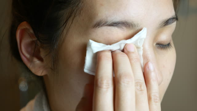 Asian Woman Face cleansing  with cotton pad video