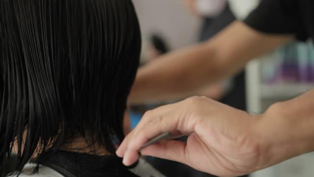 Asian woman haircut in beauty salon video