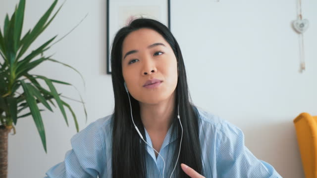 Asian woman having a job interview. Young chinese woman having a job interview using global communications. zoom call stock videos & royalty-free footage