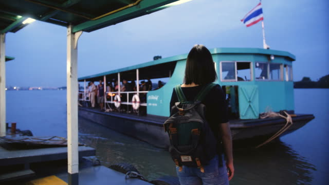 asian woman in thai taxi boat at bangkok, thailand - fiume chao phraya video stock e b–roll