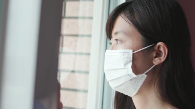 asian woman is self quarantine