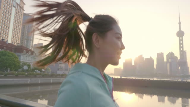 Asian Woman jogging in urban setting Chinese woman running in shanghai city shanghai stock videos & royalty-free footage