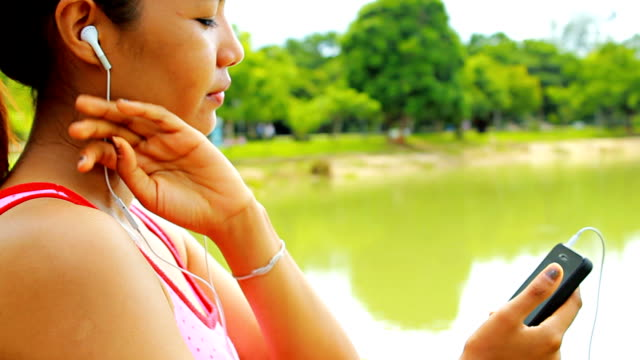 Asian Woman listen music in nature video