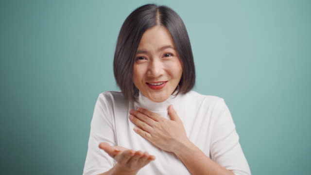 Asian woman looking at camera happy smiling and say thank you by sign language isolated over blue background. 4K video. Emotional conceps. Asian woman looking at camera happy smiling and say thank you by sign language isolated over blue background. 4K video. Emotional conceps. thank you stock videos & royalty-free footage