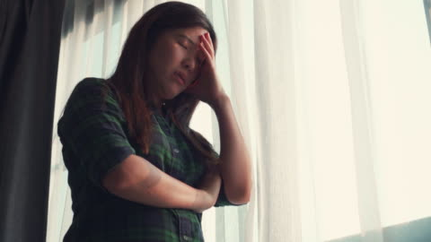 Asian woman looking through window self-quarantine for coronavirus 4k footage of Asian woman looking through window self-quarantine for coronavirus anxiety stock videos & royalty-free footage