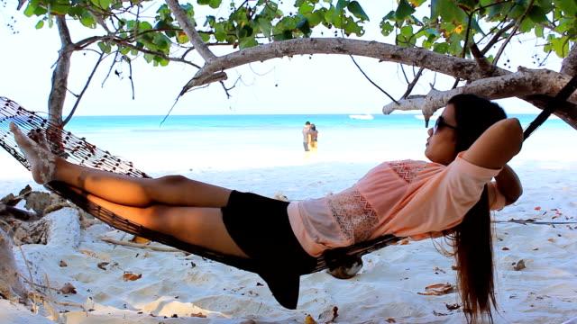 Asian woman on hammock video