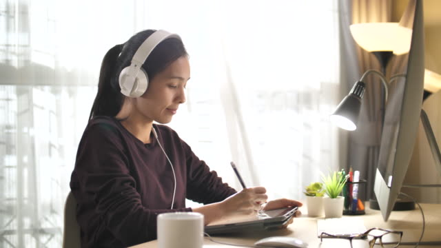 Asian Woman online Learning at home