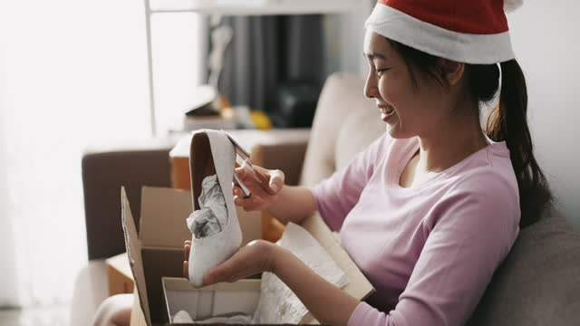 Asian Woman Open purchase Online Package at home