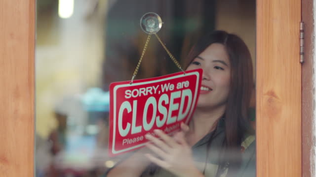 Asian woman owner closing the coffee shop