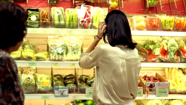 asian woman shopping groceries at super market video
