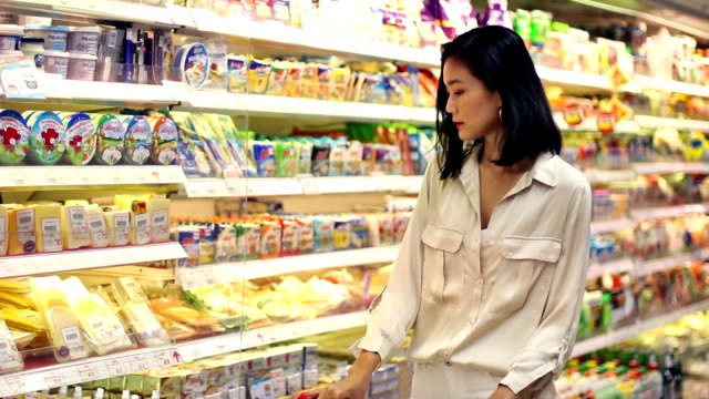 asian woman shopping groceries at super market - stay at home parent stock videos & royalty-free footage