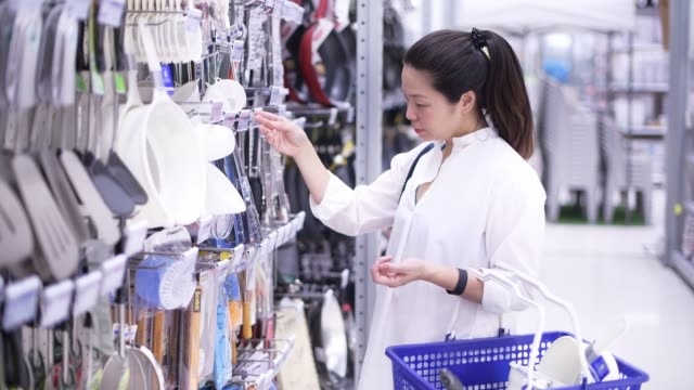 Asian woman shopping in super market Asian woman shopping in super market snack aisle stock videos & royalty-free footage