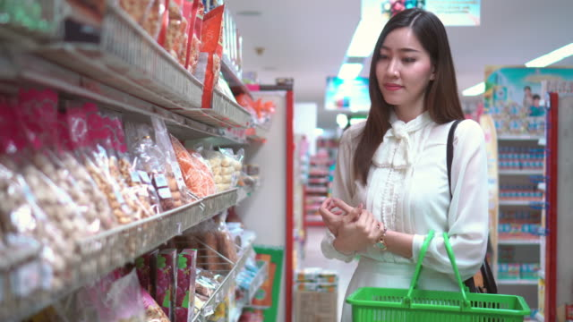 Asian woman shopping in supermarket video