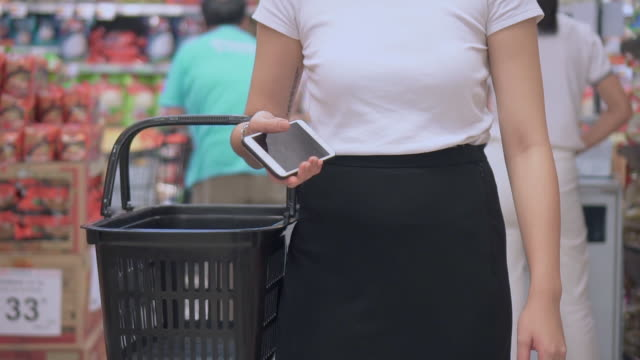 Asian woman shopping in supermarket,Slow motion