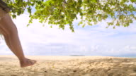 istock Asian woman Sit in a Swing chair at the beach on a clear day 1265615737