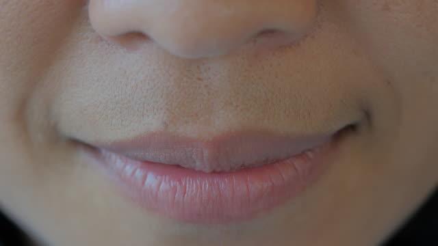 Asian woman smiling closeup video